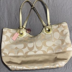 Gold and cream signature Coach bag